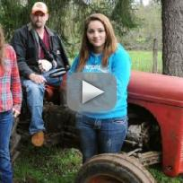 Girls Lift Tractor Off Dad
