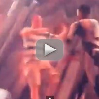 Kid cudi pushes fan off stage