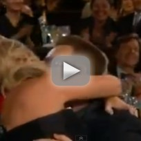 Amy poehler wins kiss bono