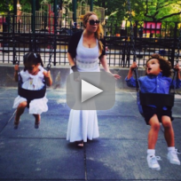 Mariah-carey-wears-ball-gown-on-swings