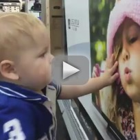Toddler falls in love at best buy