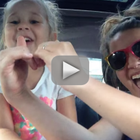 Mother and toddler lip sync to frozen