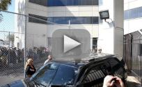 Justin Bieber Leaves Jail, Sits on Top of SUV