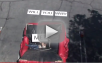 Man Falls Off Building, Proposes