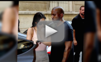 Kardashians Head to Paris, Show Off Breasts