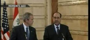 George w bush greeted warmly in iraq