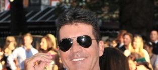 Simon cowell barred from going near baby mamas son