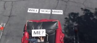 Man falls off building proposes