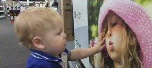 Toddler falls in love at best buy