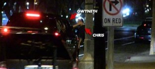Gwyneth paltrow caresses chris martin