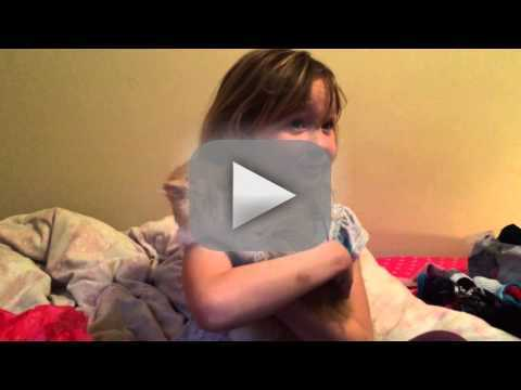 Girl Receives Kitten for Birthday