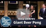 Nina Dobrev Plays Giant Beer Pong!