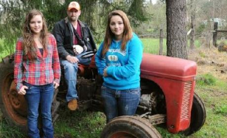 Girls Lift Tractor Off Dad, Save the Day!