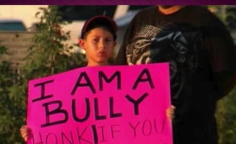 "Father Forces Son to Hold Pink ""I am a Bully"" Sign on Texas Highway"