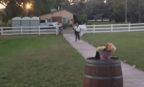 Groom Carries Bride Into Wedding Reception, Drops Her on Face
