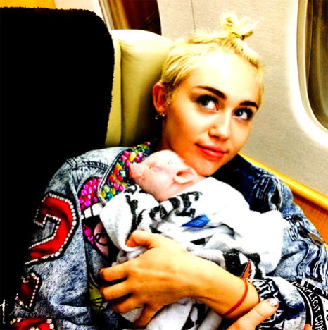 Miley Cyrus and Her Pig