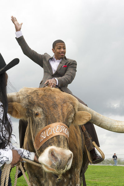 Nick Cannon on a Cow