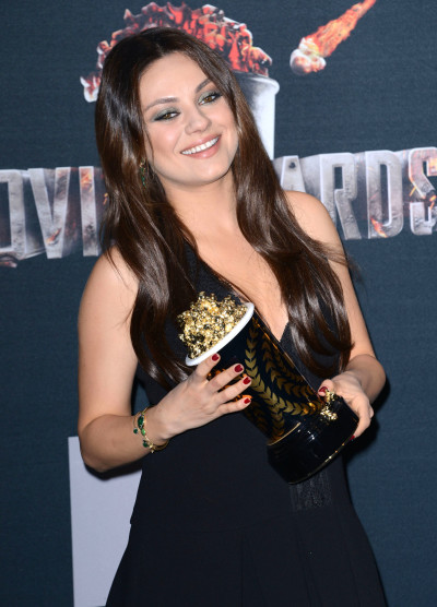 Mila Kunis with MTV Movie Award
